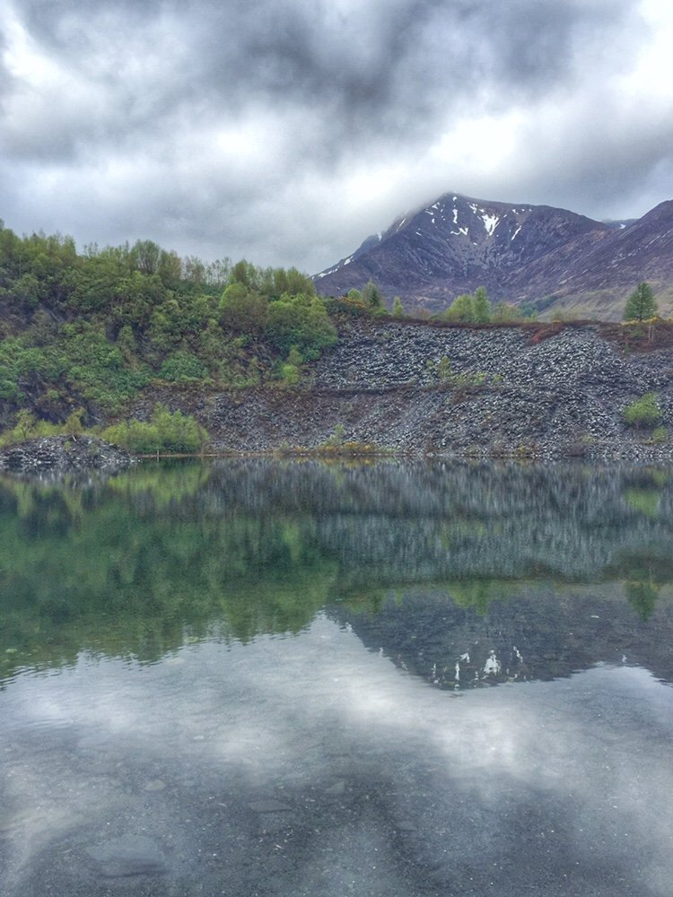 Reflections of a mountain in a lochan at Ballachulish slate quarry