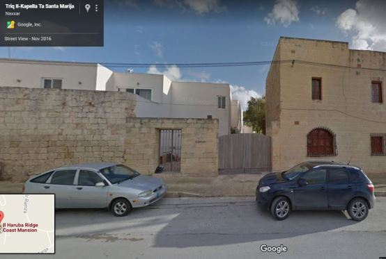 Front of Maltese building, gate, cars parked on road