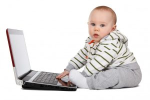 portrait-of-baby-boy-playing-on-laptop