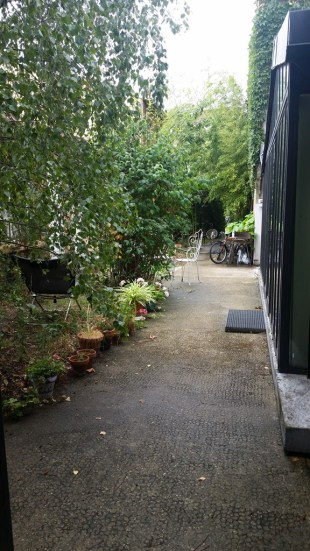An unassuming door on the street leads to this pathway, which takes you past artists' workshops to our house.