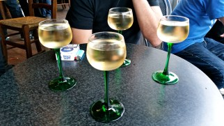 A glass of wine is necessary after a trip to the market.