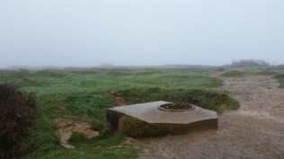 A gunner's hole at the rear of Pointe du Hoc.