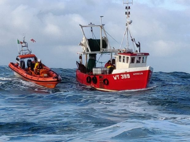 Two lifeboat crew were transferred onboard Ophelia to assist with pumping out the flooded vessel. (Photo: Clifden RNLI)
