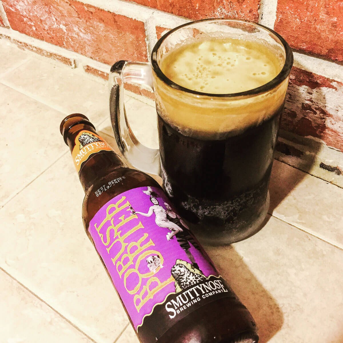 Robust Porter is an American Porter by Smuttynose Brewing Company that blends coffee grounds, roast malt, and floral hops with dark chocolate and caramel.