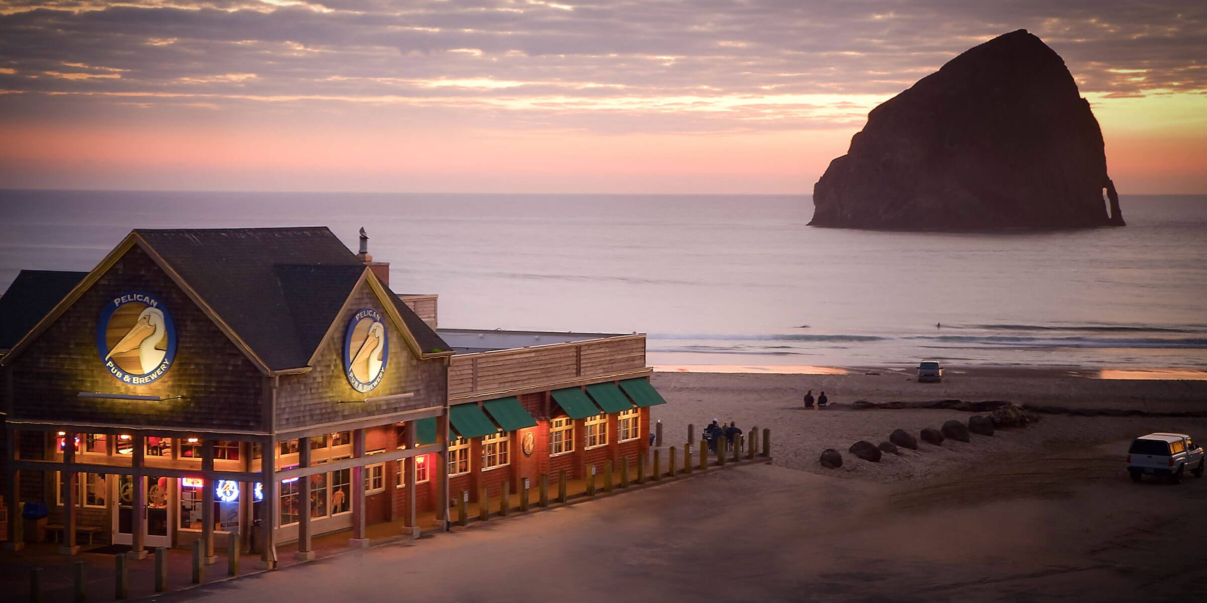 Outside the Pelican Brewing Company location on Cannon Beach at sunset