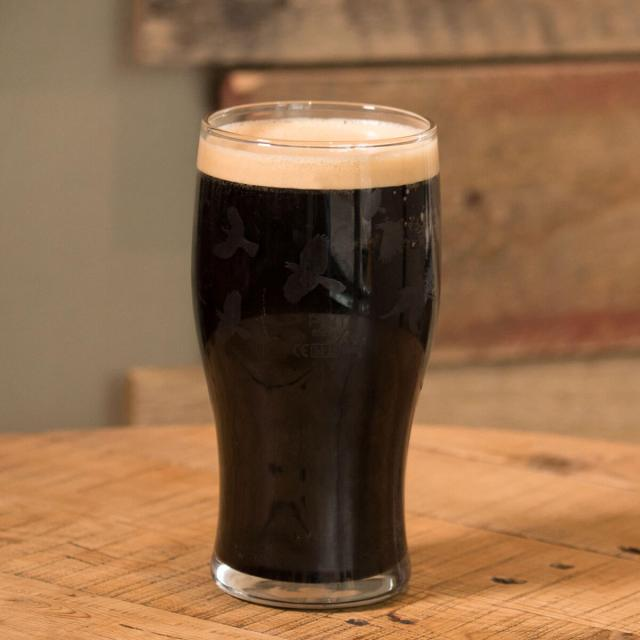 Foreign Export Stout in a Tulip Pint Glass