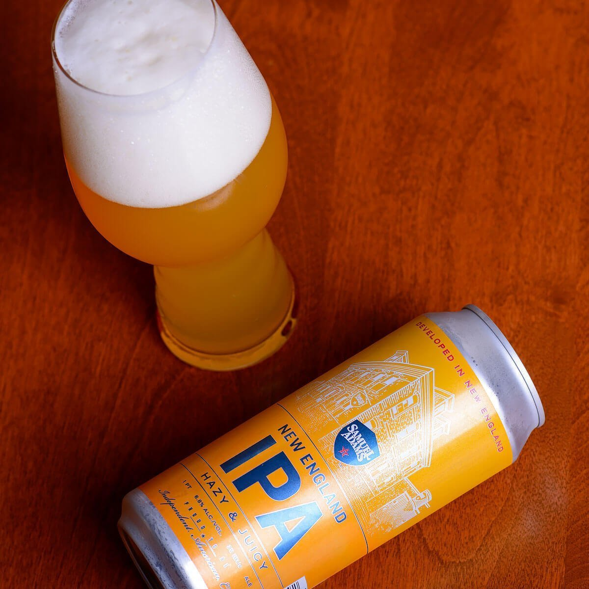 Samuel Adams New England IPA is an American IPA by the Boston Beer Company that blends hoppy citrus and pine with tropical fruit and doughy bread. Read the craft beer review.