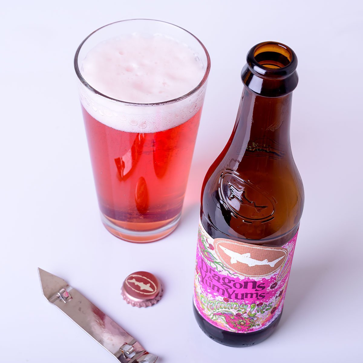 Dragons & YumYums is an American Pale Ale by Dogfish Head Craft Brewery that blends sweet and tart tropical fruit with pine, resin, and bready malt.