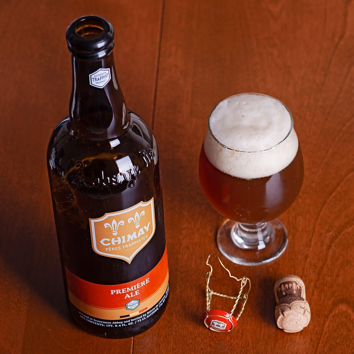 Chimay Première Red Ale is a Belgian Dubbel brewed by Bières de Chimay that balances subtle floral hops, pepper and clove spices along with stone and dark fruits.