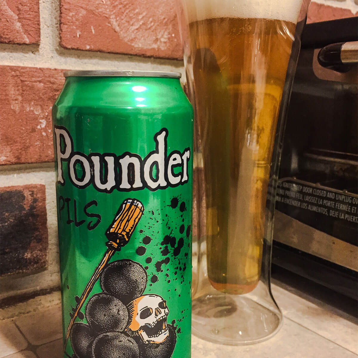 Pounder Pils is a German-style Pilsner by Heavy Seas Beer whose palate is powered by noble hops and balanced with lightly sweet malt.
