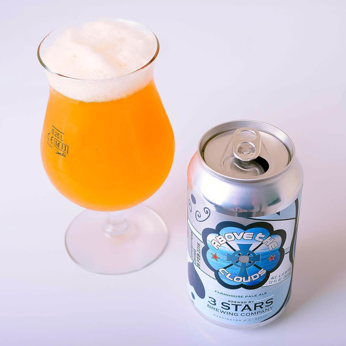 Above The Clouds is a Belgian-style Saison by 3 Stars Brewing Company that blends citrus and pepper with sourdough bread and fruity esters.