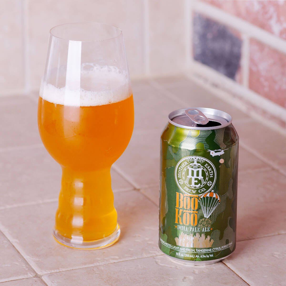 Boo Koo IPA is an American IPA by Mother Earth Brew Co. whose hoppy tangerine and pine is balanced by bready malt.