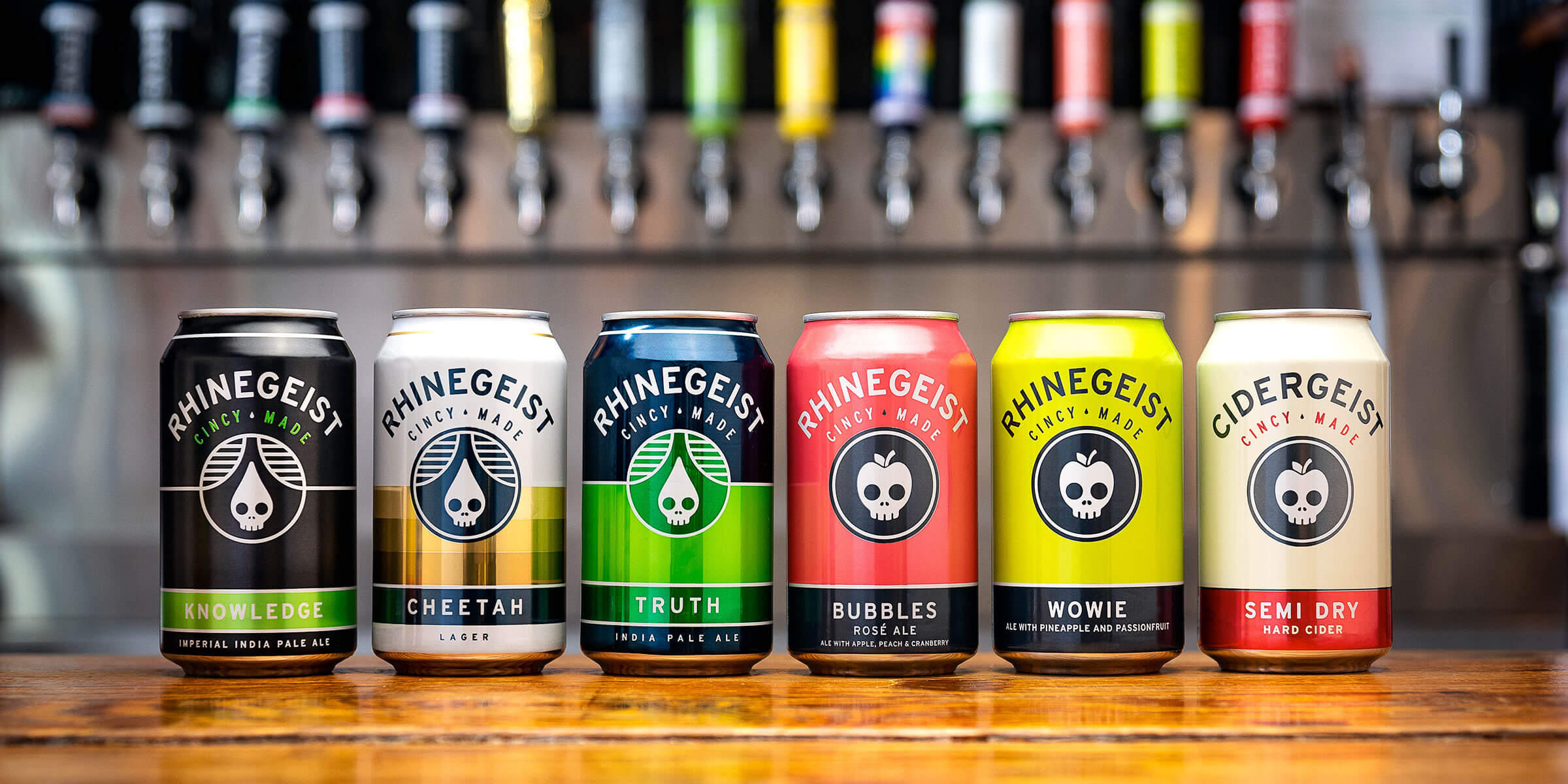A lineup of canned beers by Rhinegeist Brewery