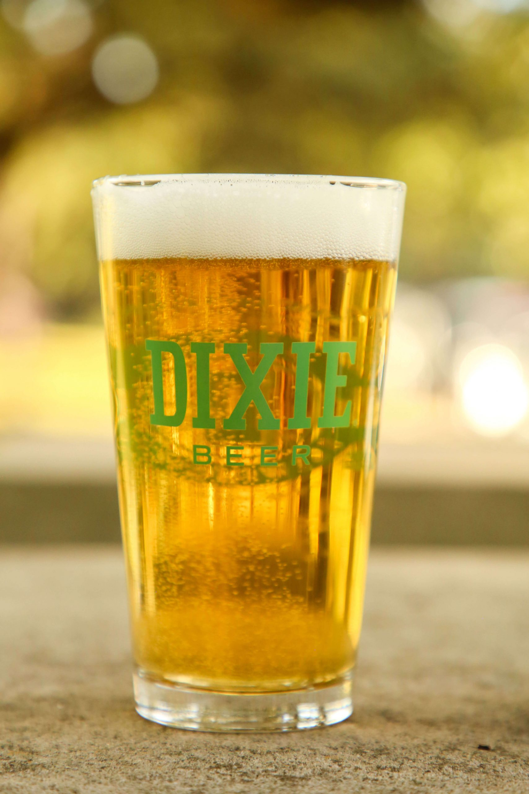 Beer in a Dixie Brewing Company branded shaker pint glass
