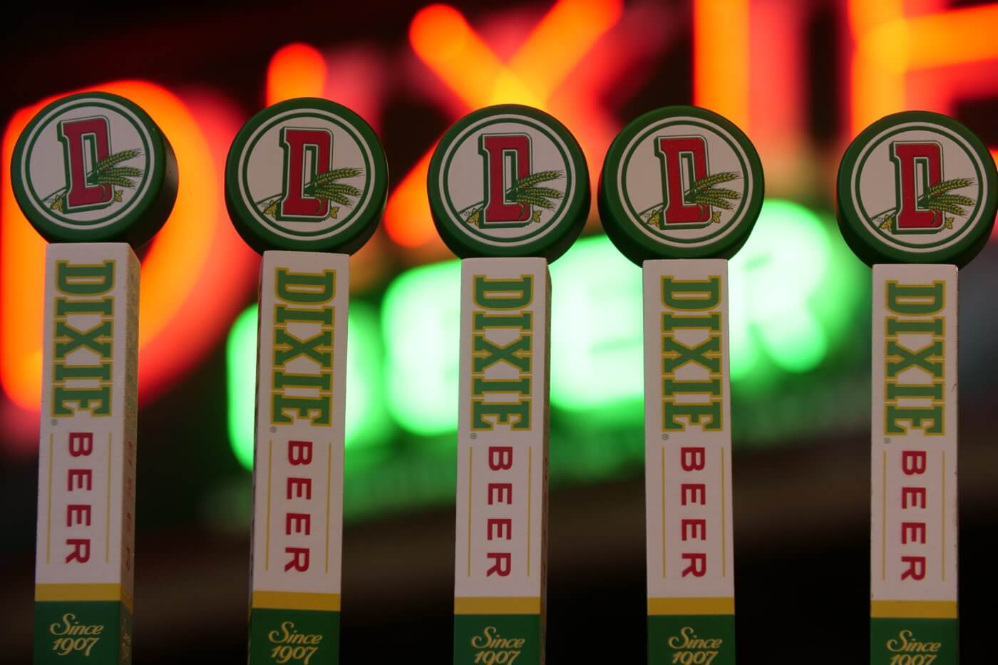 A row of tap handles inside the tasting room at Dixie Brewing Company in New Orleans, Louisiana