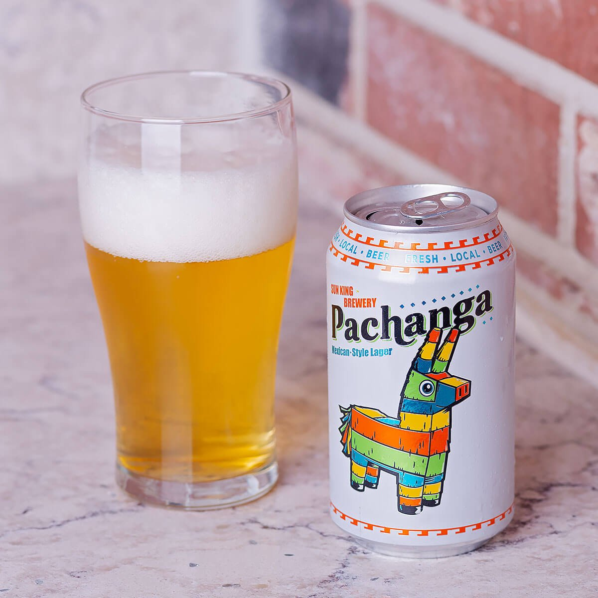Pachanga is an International Pale Lager by Sun King Brewery that blends corn, cracker, and honey with floral, peppery hops and lime.