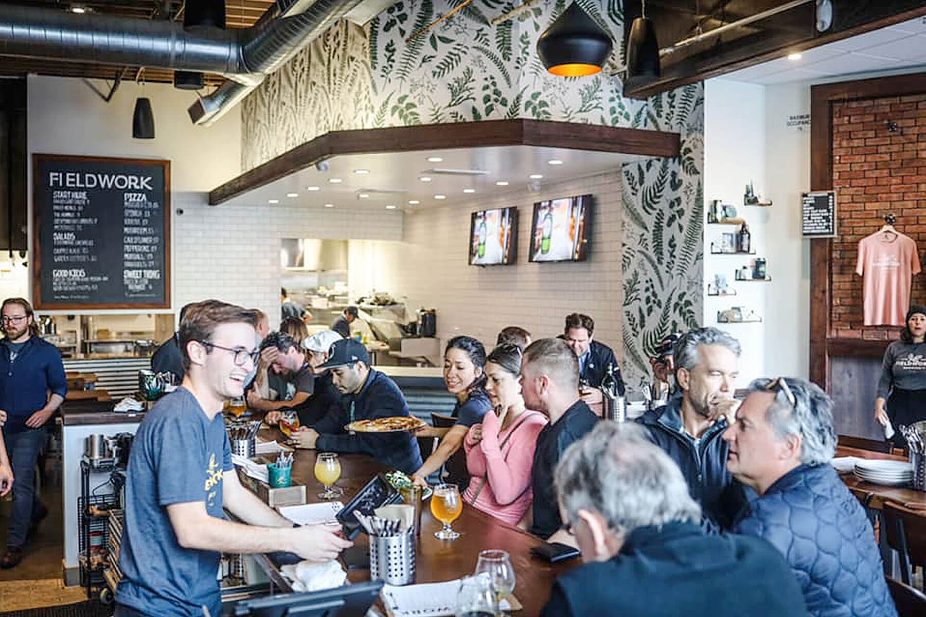 Patrons enjoy food and beer in the taproom at Fieldwork Brewing Company in Corte Madera, California