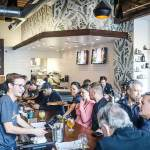 Thumbnail of http://Patrons%20enjoy%20food%20and%20beer%20in%20the%20taproom%20at%20Fieldwork%20Brewing%20Company%20in%20Corte%20Madera,%20California