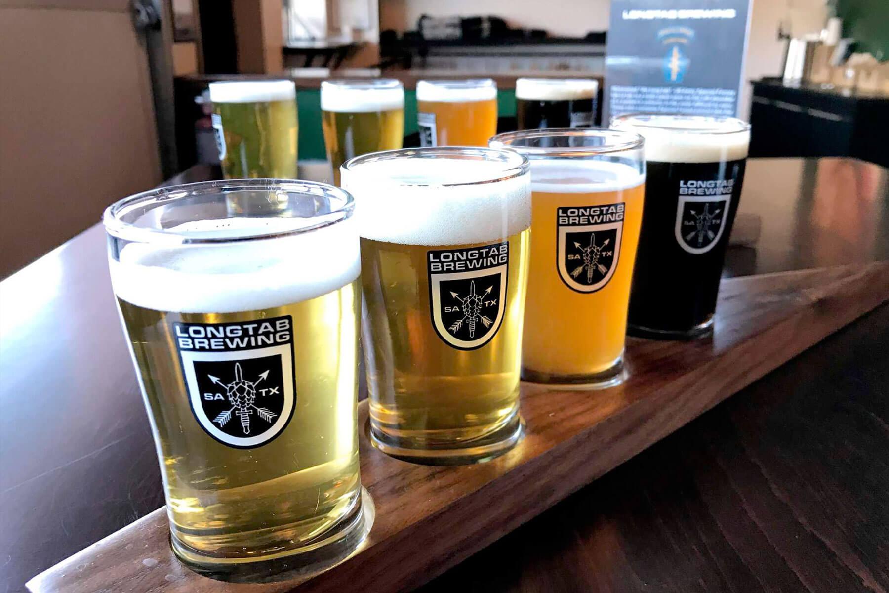 A flight of beers in Longtab Brewing Company branded sampler glasses