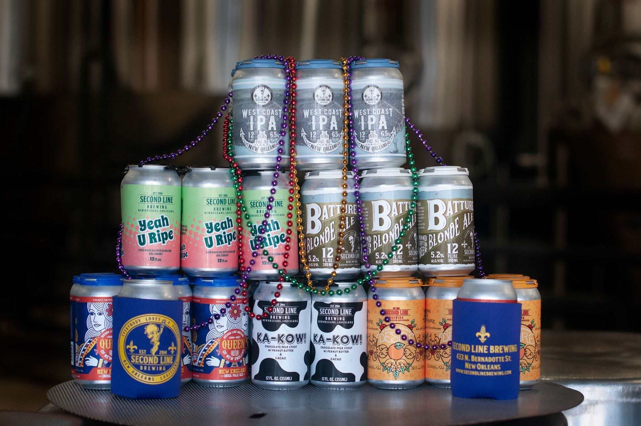 Six packs of canned beers offered by Second Line Brewing