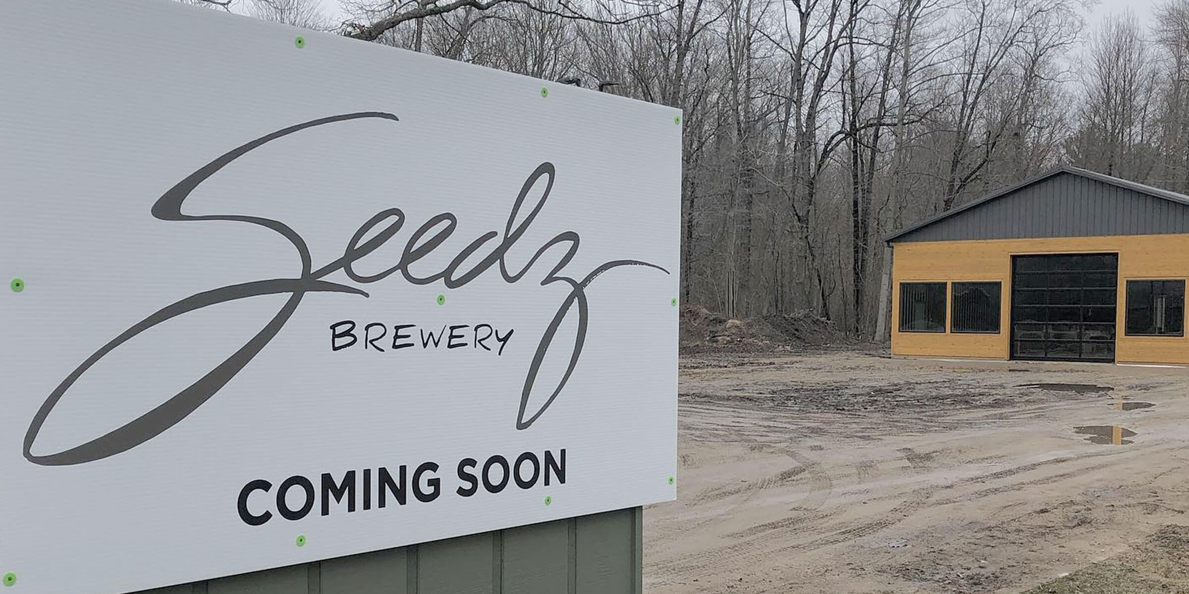 Temporary signage posted outside Seedz Brewery while under development in Union Pier, Michigan