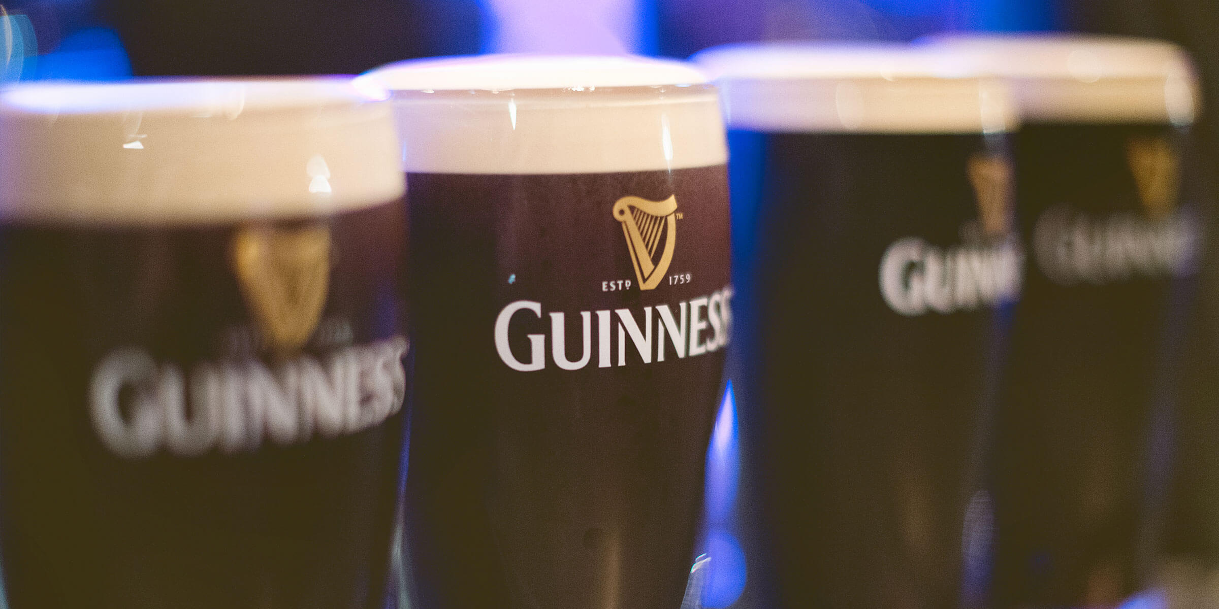 Pints of Guinness Draught in Guinness branded glasses