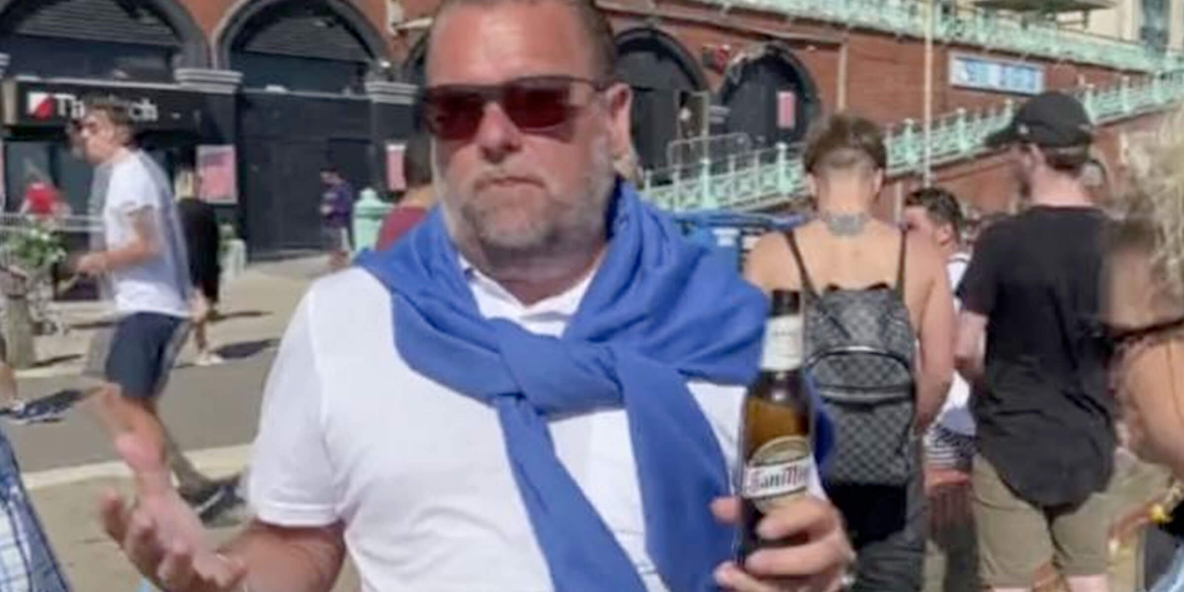 While a crowd enoyed the Brighton's seafront, one man drinking a beer was caught on camera complaining about the easing of lockdown restrictions.