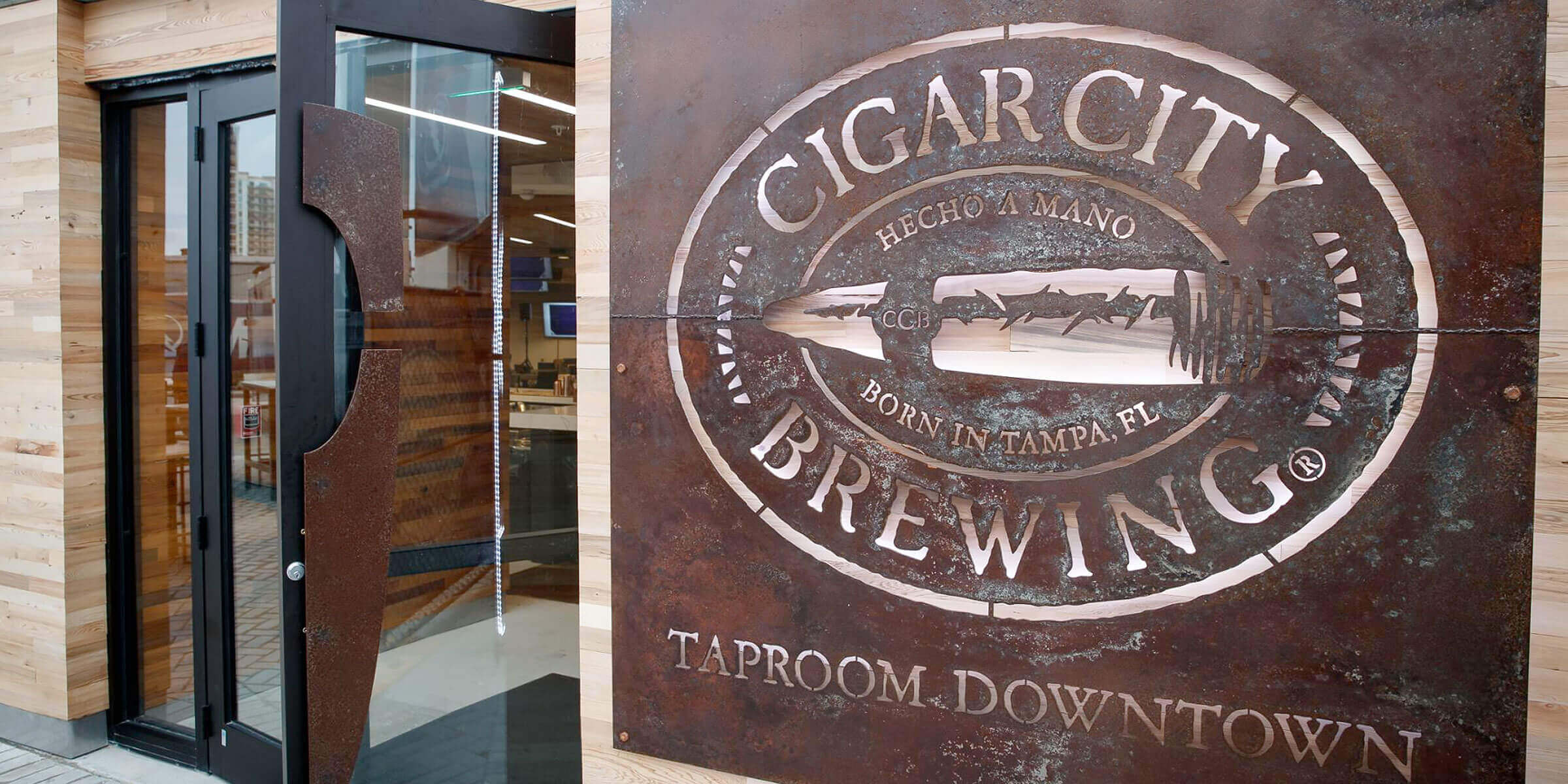 Outside the entrance to the Cigar City Brewing Taproom Downtown at AMALIE Arena in Tampa, Florida