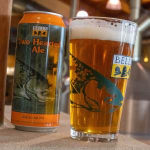 Pints of beer beside a 12 oz. can of the Two Hearted Ale by Bell's Brewery, Inc.