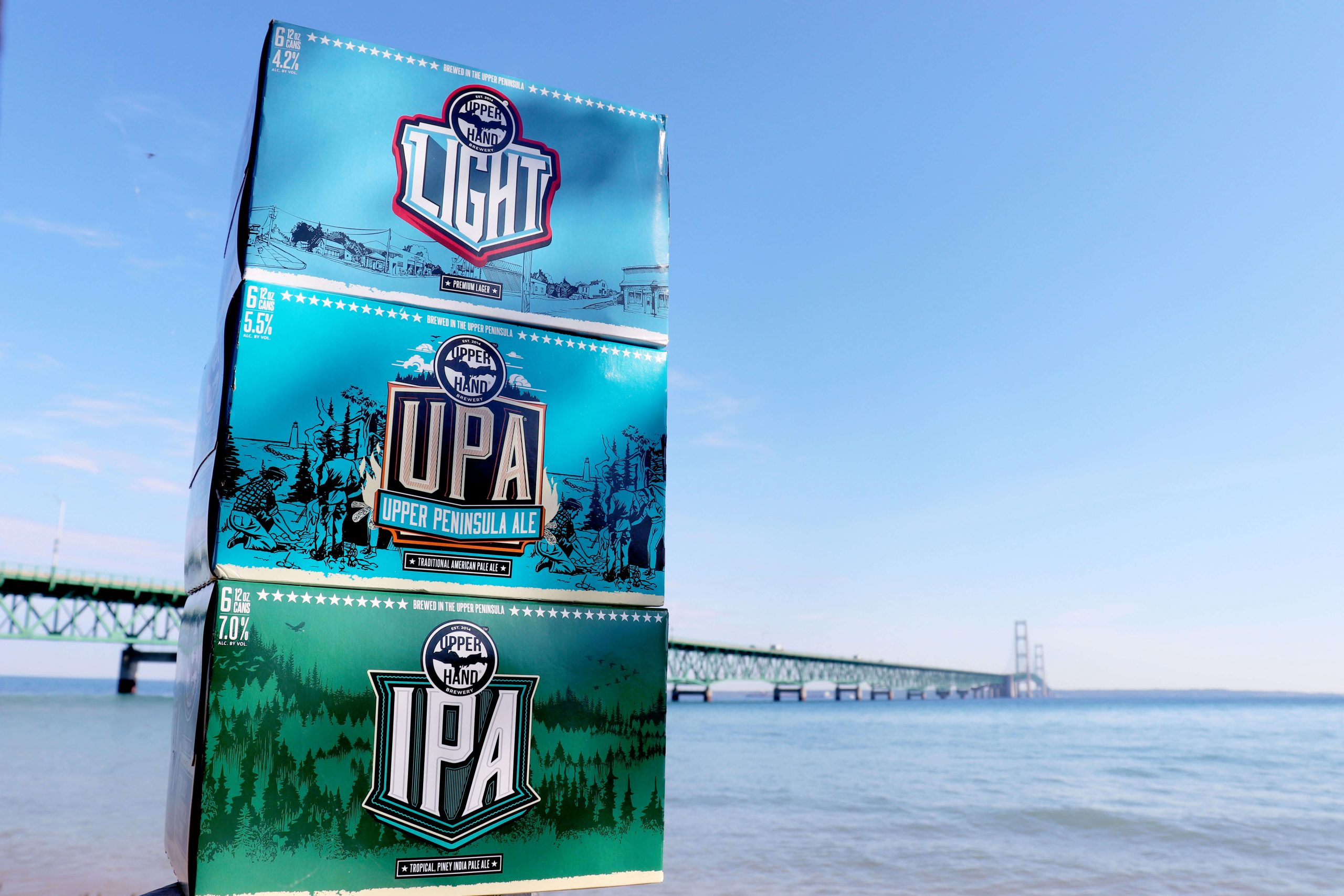 Six packs of Upper Hand Light, Upper Hand Peninsula Ale (UPA), and Upper Hand IPA by Upper Hand Brewery