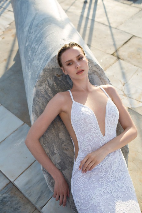 576c90955d With a sexy swimwear cut to show off that tanned beach body, this Nurit Hen  gown features thin straps, sleek cutaway styling and exquisite lace.