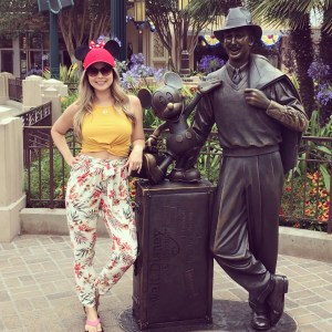 disneyland outfit minnie mouse ears standing next to walt disney statue