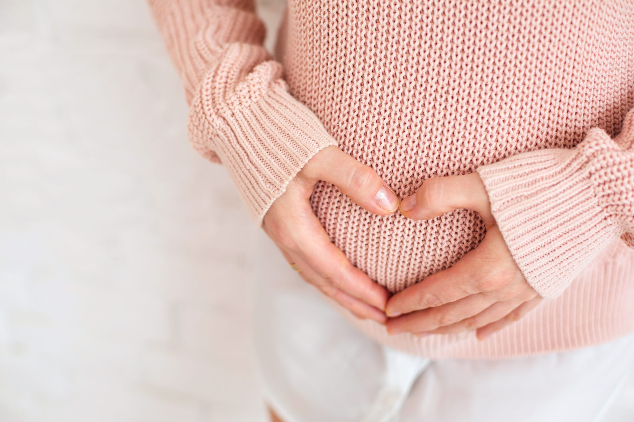 pregnant girl heart hands over belly absolutely adell