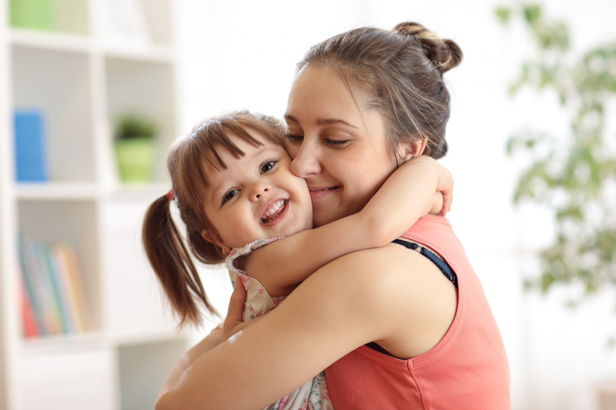 love and family people concept - happy mother and child daughter hugging at home absolutely adell