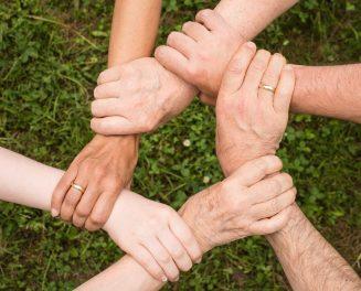 six hands interlocking