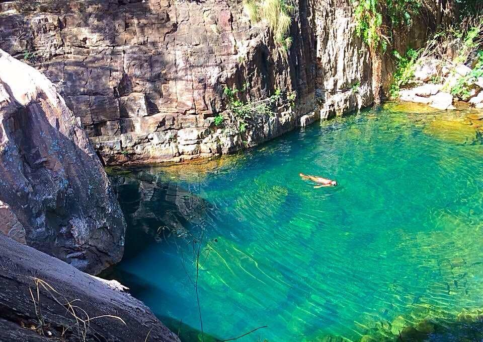 travelling by yourself, solo travel, Absolutely Lucy floating alone in hidden lake in national park australia