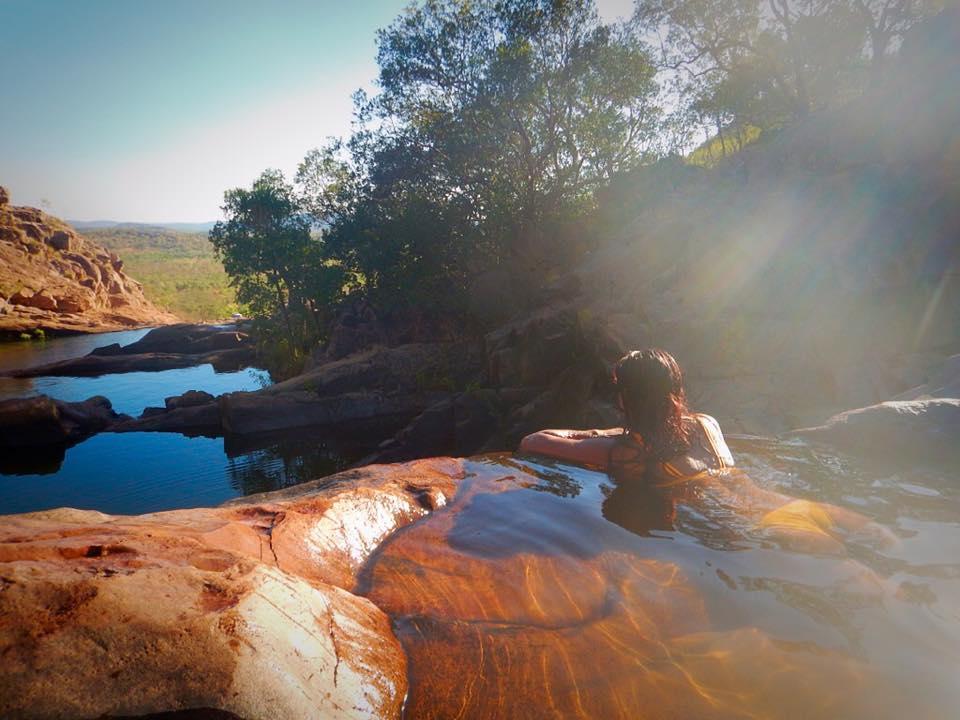 solo travel, solo female travel, girl in yellow bikini at waterfall, kakadu national park, australia, northern territory