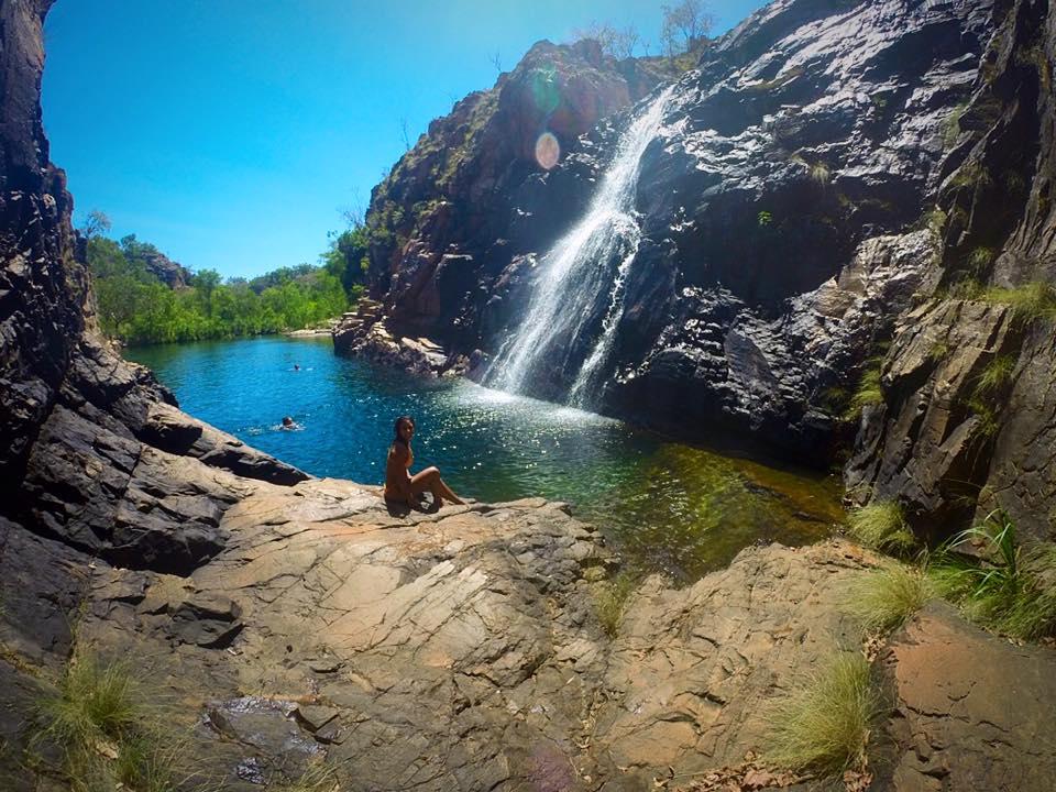 solo backpacking, solo travel, girl in yellow bikini at waterfall, kakadu national park, australia, northern territory
