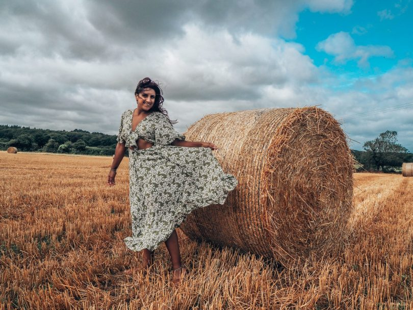 Absolutely Lucy with hay bale, Norfolk, travel sustainably