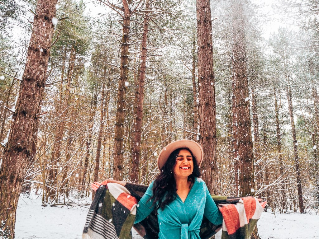 girl profile in brown hat with green dress and patterned scarf, Forest bathing in Norfolk, snow, outdoor nature activities