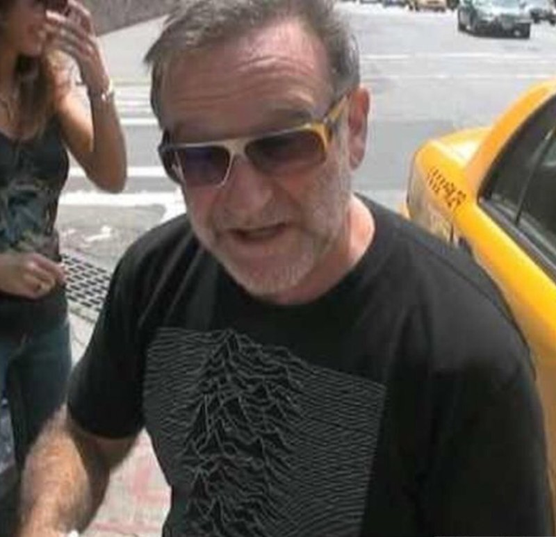 Robin Williams wearing a Joy Division concert T-Shirt.