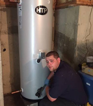 Technician Dane Kady installing an 80 gallon indirect fired water heater by Super Store