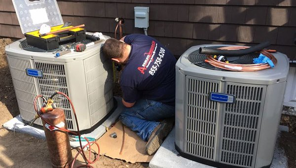 Two newly installed American Standard AC systems are brought online by Dane of Absolute Precision Plumbing Heating & Cooling