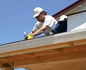 Roofer Repairing Soffit