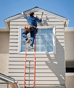 Roofer Repairing Siding