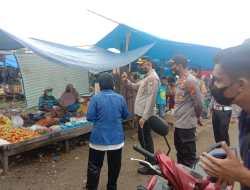 Polsek Popayato Berikan Bantuan Sembako Untuk Warga yang Taat Prokes