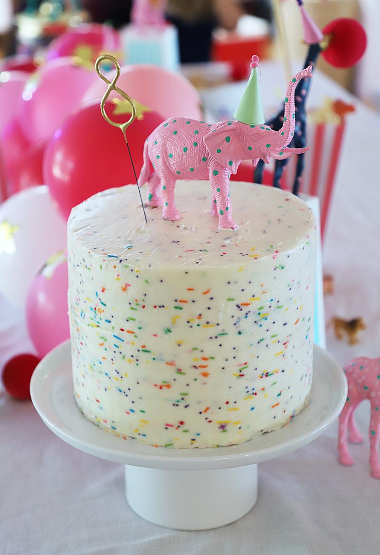 elephant cake topper on sprinkle cake