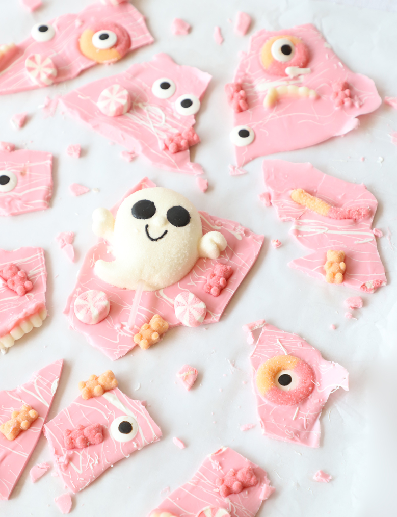 pink halloween candy bark with tons of pink and pastel colored candies & a white ghost