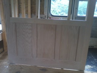 Some nice flat panel wainscoting in the galley/bathroom wall.