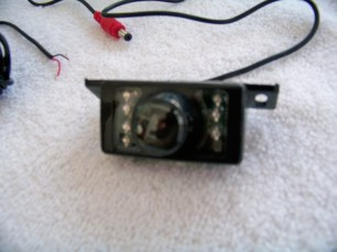 IR augmented camera. 7 IR LEDs and one photocell sensor.